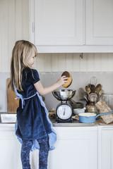 Sweden, Little girl (4-5) cooking