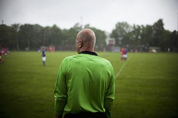 Sweden, Referee standing on soccer field