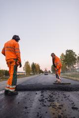 Sweden, Narke, Three manual workers repairing road