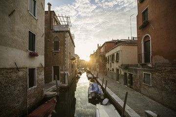 Italy, Venice, Gondolas in canal at sunset