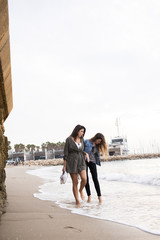 Israel, Tel Aviv, Young women walking on beach