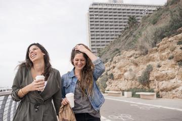 Israel, Tel Aviv, Two smiling women on promenade