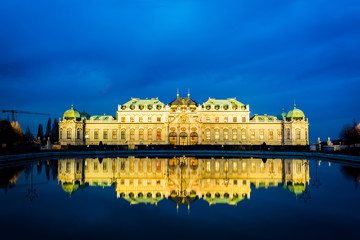Belvedere Palace reflecting in a pool at night, in Vienna, Austr