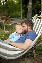 Sweden, Father and son (2-3) in hammock