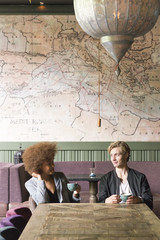 Sweden, Vastra Gotaland, Young couple in cafe