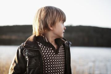 Sweden, Vastergotland, Frufallan, Portrait of boy (4-5) with lake in background