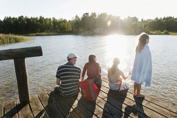Sweden, Vastra Gotaland, Kallandso, Family with two children (6-7, 12-13) on pier