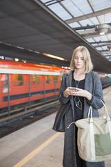 Finland, Uusimaa, Helsinki, Young woman using smartphone