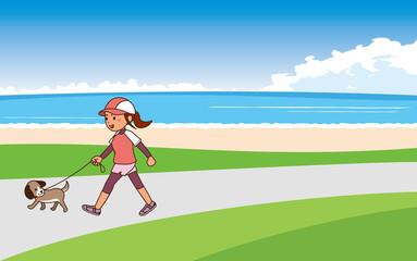 海辺で犬の散歩をしながらウォーキングをする女性