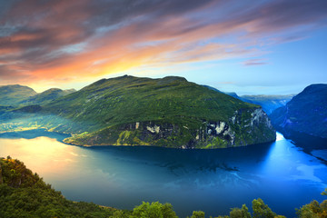 Norway, More og Romsdal, Sunnmore, View of lake in mountains at sunrise