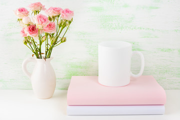 Coffee mug mockup with books and pink roses