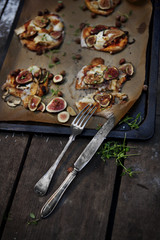 Pizza on parchment paper in baking tray