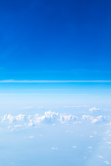 Aerial view of cloud and sky from airplane,Traveling concept