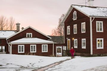 USA, Dalarna, Jarvso, Teenage girl (12-13) walking from house in winter