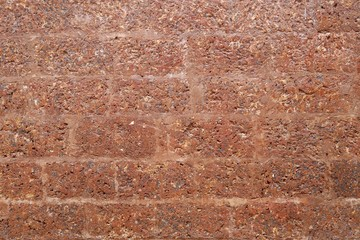 laterite wall, house fence made from laterite