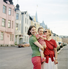 Finland, Uusimaa, Helsinki, Portrait of mother, grandmother and child (2-3) on street
