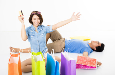 happy young Couple with shopping bags and credit card