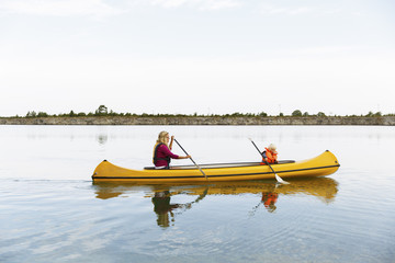 Sweden, Gotland, Farosund, Mother and son (2-3) kayaking on river