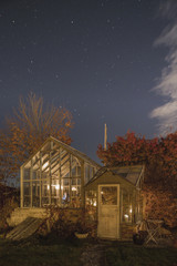 Exterior view of illuminated greenhouse at night