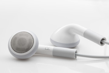 Ear buds isolated on a white background