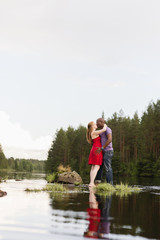 Sweden, Vastmanland, Bergslagen, Svartalven, Mid adult couple kissing