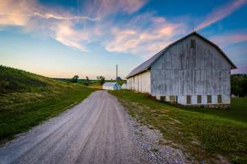 Barn along a dirt road at sunset, near Seven Valleys in rural Yo Wall mural