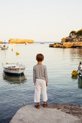 Spain, Menorca, Picture of boy (6-7) looking at sea
