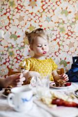 Sweden, Boy (10-11) and girl (2-3) eating cake
