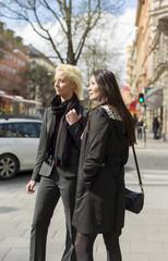 Sweden, Uppland, Stockholm, Sveavagen, Two women standing in city street