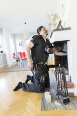 Sweden, Mid-adult man cleaning chimney