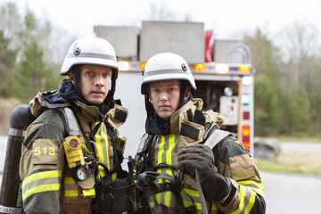 Sweden, Sodermanland, Tumba, Portrait of two young firefighters