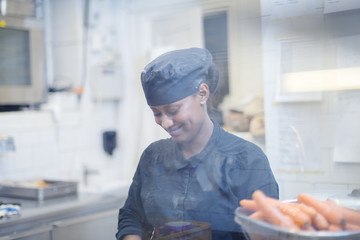 Sweden, Woman in cafe kitchen