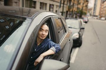Sweden, Sodermanland, Stockholm, Sodermalm, Young man in car