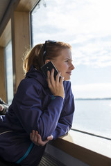 Finland, Uusimaa, Woman on ferry, looking through window