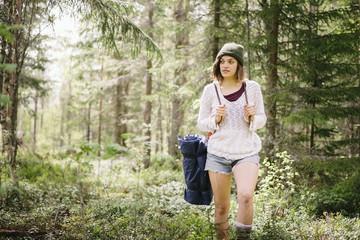 Sweden, Vasterbotten, Norrmjole, Young female hiker in forest