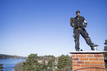 Chimney cleaner standing on chimney