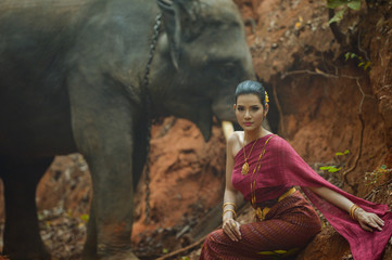 Beautiful Woman andYoung elephant in Thai culture traditional ,vintage style