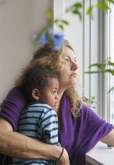 Denmark, Copenhagen, Fredriksberg, Mother and son (4-5) looking through window
