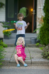 Sweden, Vastergotland, Lerum, Siblings (4-5, 6-7) playing in front of their house