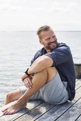Sweden, Stockholm Archipelago, Grasko, Portrait of man on jetty