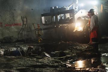 Sweden, Norrbotten, Kiruna, Miners working underground