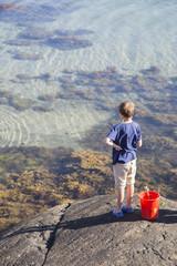 Sweden, Swedish West Coast, Halland, Kungsbackafjorden, Boy (12-13) playing by sea