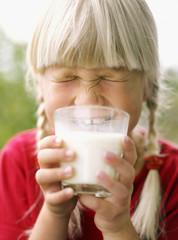 Sweden, Cute blonde girl (6-7) drinking milk