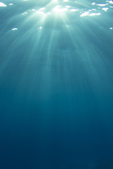 Underwater blue ocean background with sunlight in sea