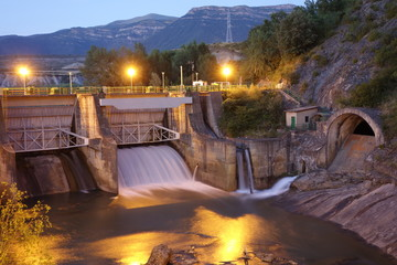 Poster Barrage Dam at night in Sabiñanigo town, Spain. Taken on the 8th of July of 2016
