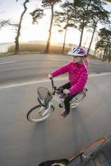 Sweden, Vastergotland, Lerum, Girl (8-9) riding bike