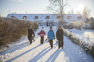 Children walking on snowy driveway