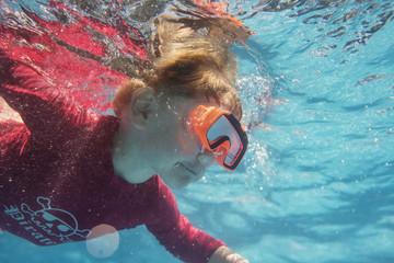 Turkey, Mugla, Marmaris, Boy (4-5) diving underwater with swimming goggles