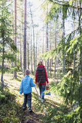 Finland, Espoo, Mother and son (6-7) hiking in forest
