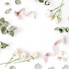 empty wreath frame with roses, eucalyptus branches, leaves and spool with ribbon isolated on white background. flat lay, overhead view
